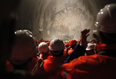 77646-miners-watch-as-the-drill-machine-sissi-breaks-through-the-rock-at-the